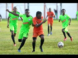 Tivoli Gardens' Jermaine Johnson evades the challenge of Molynes FC defender, Sergeni Frankson in the teams' RSPL encounter at the Edward Seaga Sports Complex on December 11.