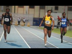 Jamaica's Briana Williams (centre) storms to victory in the Under 20 Girls 100m final at the 48th staging of the Carifta Games at the Truman Bodden Sports Complex in George Town, Cayman Islands on April 21, 2019.