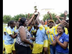 Waterhouse Women FC celebrate with their JFF Women's League Mid Season final trophy after defeating Arnett Gardens 2-1 in the final on Sunday, August 19, 2018.