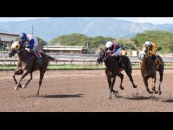 AZARIA (left) ridden by Oshane Nugent, finishes ahead of CONTRACTOR, ridden by Aaron Chatrie at Caymanas Park on Saturday, February 1.
