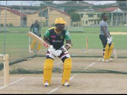 Jamaica Tallawahs captain Rovman Powell (centre) bats during a training session at the UWI ground in Trinidad and Tobago. Looking on are Jermaine Blackwood (left) and Nkrumah Bonner.