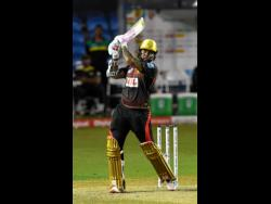 Sunil Narine of Trinbago Knight Riders hits a six during the Hero Caribbean Premier League match 6 between Trinbago Knight Riders and Jamaica Tallawahs at Brian Lara Cricket Academy  in Trinidad And Tobago last night.