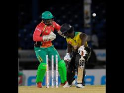 Chadwick Walton (right) of Jamaica Tallawahs is bowled by Imran Tahir of Guyana Amazon Warriors during the Hero Caribbean Premier League match 12 on August 25 in Port of Spain, Trinidad And Tobago.