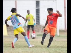 File Rafiek Thomas (left) of Waterhouse FC goes up against Tivoli Garden's Ranike Anderson in a  Red Stripe Premier League match played at the Edward Seaga Sports Complex in Kingston last February.
