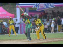 Gayle Cricket Club's Jermaine Chisholm (left) plays a shot in his innings against Orange Hill in the final of the Social Development Commission Twenty20 Community Cricket Competition on Sunday, August 27, 2019.