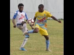 In this file photo from November 2019, Tremaine Stewart (right), then of Waterhouse FC, controls the ball under pressure from Portmore United's Tevin Shaw during a Jamaica Premier League game at the Spanish Town Prison Oval in Spanish, Town, St Catherine.