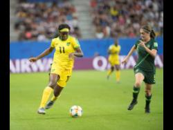 Khadija Shaw (left) in action against Australia during the 2019  FIFA Women's World Cup in France.