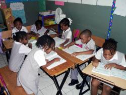 Grade One students of Quest Preparatory School are busy reading their books in this 2010 photo.