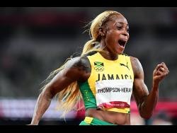 Elaine Thompson-Herah reacts following her win in the 100m women's final at the Tokyo 2020 Olympic Games in Tokyo, Japan at the Tokyo Olympic stadium on Saturday July 31, 2021. Thompson-Herah will be looking to break the women's 100m world record today.