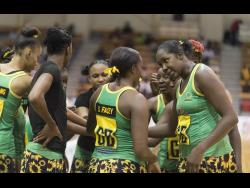 Jamaica's Sunshine Girls captain, Jhaniele Fowler (right), speaking with teammates during a team huddle.