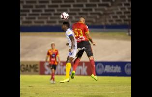 Waterhouse FC's Colorado Murray (left) and CS Herediano's Chrisian Reyes duel for an aerial ball in their Scotiabank Concacaf League game at the National Stadium on Thursday, August 22, 2019.