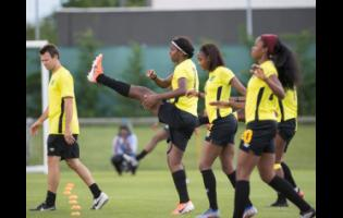 National senior women's footballers Khadija Shaw (centre), Sashana Campbell (second right), and Cheyna Matthews warm up during a training session at Stade Eugene Thenard in Grenoble, France at the FIFA Women's World Cup on Monday, June 17, 2019. Also pictured is fitness coach Will Hitzelberger.
