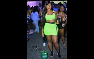 Moyisha looks flawless in this neon green outfit.