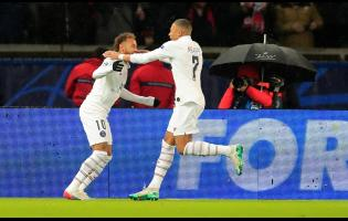 PSG's Neymar (left) celebrates with his teammate Kylian Mbappe, after scoring his side's third goal during the Champions League, Group A football match between PSG and Galatasaray, at the Parc des Princes stadium in Paris, on Wednesday.