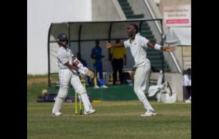 Jamaica Scorpions fast bowler Marquino Mindley (right) celebrates after picking up the wicket of Barbados Pride wicketkeeper-batsman Shane Dowrich at Sabina Park yesterday.
