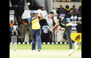 St Lucia Zouks batsman Rahkeem Cornwall (left) plays a stroke off Jamaica Tallawahs pace bowler Oshane Thomas' delivery during their Caribbean Premier League match at Sabina Park on Thursday, September 12, 2019.