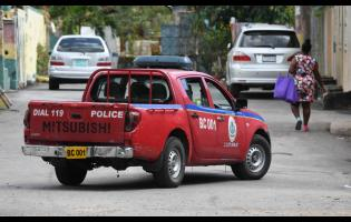 A police service vehicle patrols Kew Lane in the St Andrew South Police Division, which recorded 17 murders and 20 shootings in the first 45 days of the year.