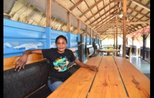 Jennifer Harvey sits in the empty Rocky Point White Sand Beach Seafood Restaurant in Clarendon on Thursday.