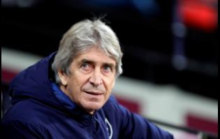 FILE In this Monday, December 9, 2019 file photo, West Ham's manager Manuel Pellegrini looks out from the bench before their English Premier League match against Arsenal at the London Stadium in London.