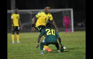 Jamaica's Alvas Powell attempts to go past Guyana's Trayon Bobb during a Concacaf Nations League match at the Montego Bay Sports Complex on Novembert 18, 2019.