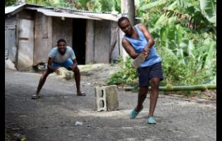 Residents of Hayfield, St Thomas, enjoying a friendly game of cricket. They say crime is non-existent in the community, and they are determined to keep it that way.