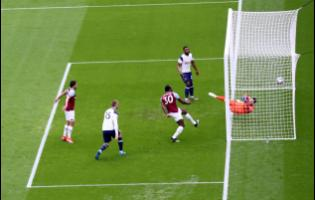 West Ham's Michail Antonio (third left) scores his side's opening goal during the English Premier League soccer match between West Ham United and Tottenham at the London Stadium in London, Saturday, February 21, 2021.