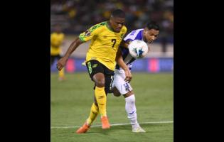 Jamaica's Leon Bailey (left) gets to the ball before Honduran defender Emilio Izaguirre in their Concacaf Gold Cup encounter at the National Stadium in Kingston on Monday, June 17, 2019.