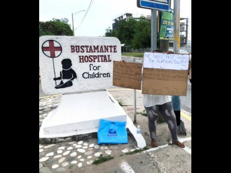 Camille Bowen protesting in front of the Bustamante Hospital for Children last Friday.
