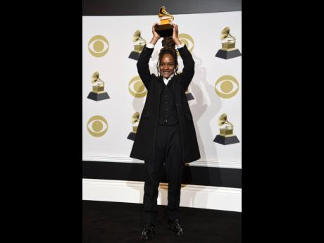 Koffee raises aloft the award for Best Reggae Album for 'Rapture' at the 62nd annual Grammy Awards at the Staples Center in Los Angeles this year.