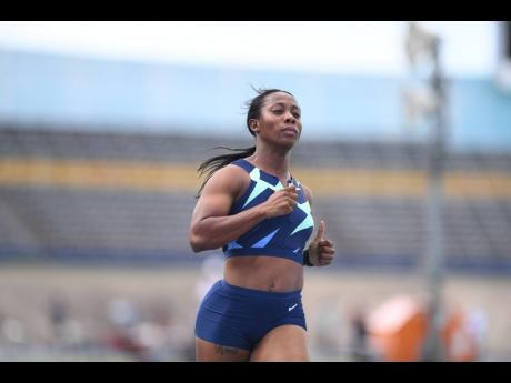 Shelly-Ann Fraser-Pryce crosses the finish line in a time of 10.87 seconds to win heat one of the women's 100m sprint at the Velocity Fest Track Meet at the National Stadium on Saturday.