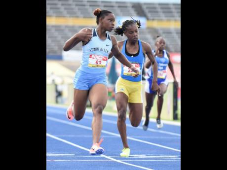 Edwin Allen High School's Tina Clayton wins the Class Two girls' 100m finals on Thursday at the National Stadium.