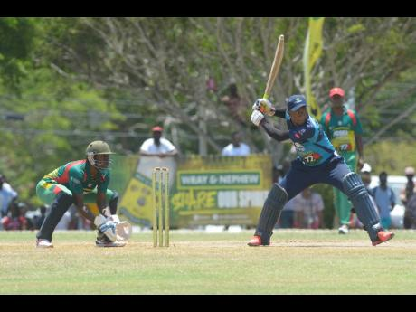Johnson Mountain's Jair Campbell (right) in action against Gayle at the Ultimate Cricket Oval in St Ann during the SDC National Twenty20 cricket competition on Sunday, August 11, 2019.