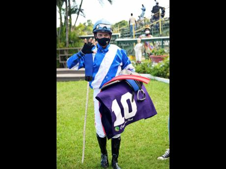 Dick Cardenas indicates riding a handful of winners after scoring aboard his fifth winner, CURLIN'S FLIGHT, in the 10th race at Caymanas Park on Saturday.