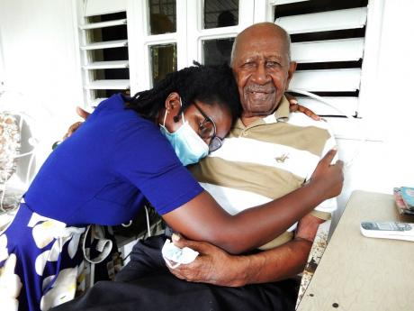Alphonso Williams gets a hug from granddaughter Alejandra, who he says is his favourite.